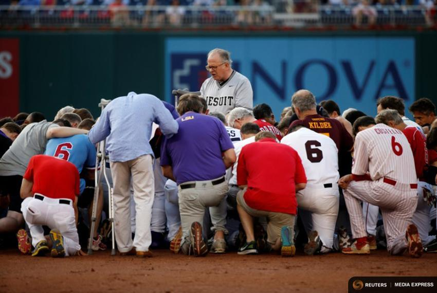 Patrick Conroy, Chaplain of the House of Representatives, leads Democrats and Republicans in prayer before they face off in …