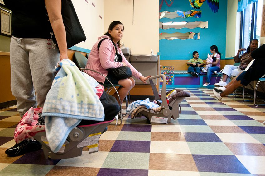 Patients wait to be seen at the People's Community Clinic in Austin, on Nov. 8, 2010. Founded in 1970, the People's Community Clinic is a primary care center for the medically under served and uninsured.