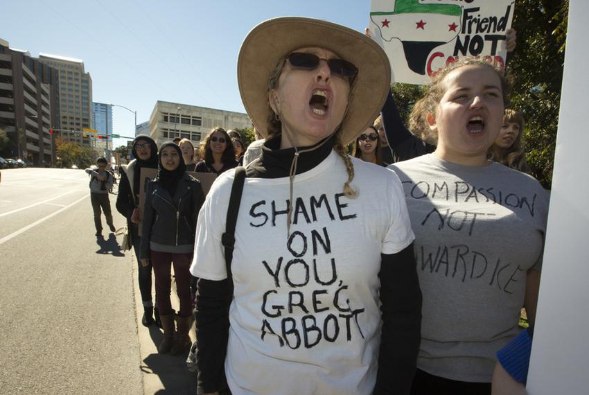Woman participates in the rally to protest Gov. Abbott's decision not to accept at Syrian refugees on November 22, 2015