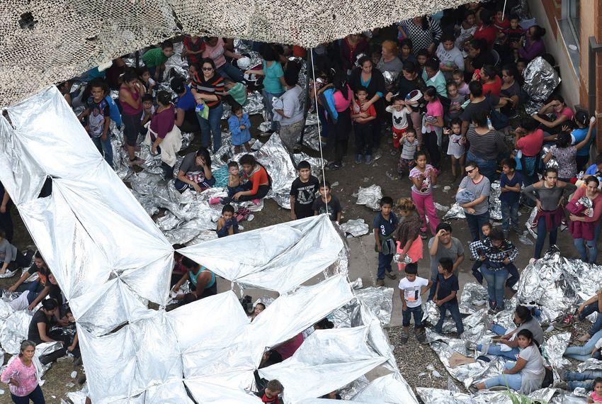 Migrants in a makeshift encampment outside the U.S. Border Patrol McAllen Station.