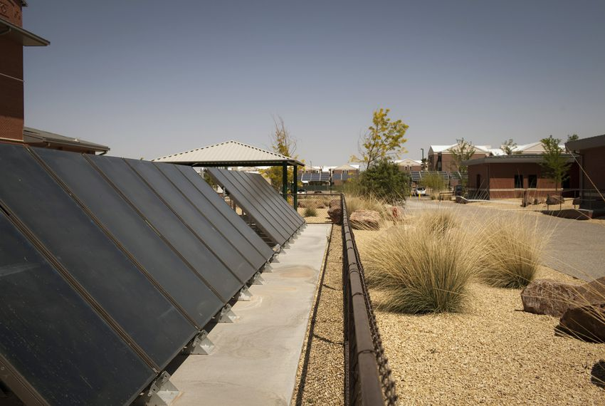A solar field provides power for a water heating system and xeriscaping on a Fort Bliss Army installation.