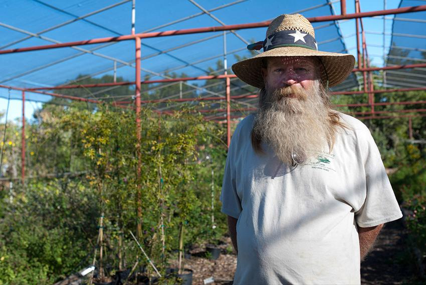 Paul Dowlearn poses for a portrait at Wichita Valley Nursery in Wichita Falls on Oct. 7. Dowlearn has been collecting rain w…