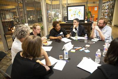 "Attendees talk during the group discussion portion of The Texas Tribune event, ""Blocked Out: A Conversation On Affordable Housing,"" in Dallas on Oct. 29, 2018."