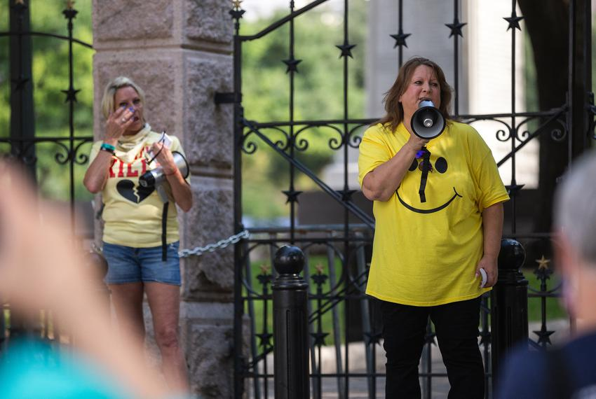 Mary Nichols, founder of Texas Caregivers for Compromise and organizer for the event, reads names of people who have lost ...