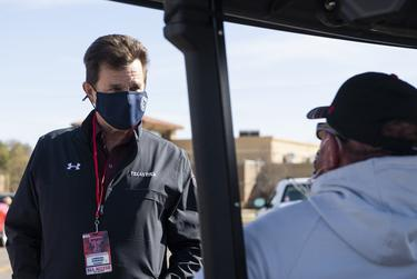 Texas Tech University President Lawrence Schovanec talks to Keith Kiser before Texas Tech's home coming game against West Virginia at Texas Tech on Saturday in Lubbock.
