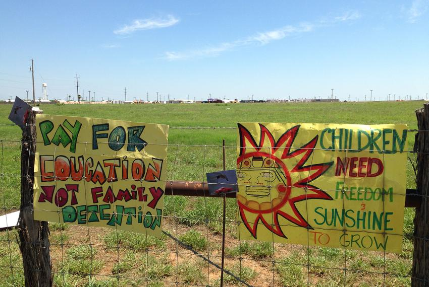 Protestors left their signs on the fence surrounding the South Texas Family Residential Center near Dilley, Texas on May 2, …