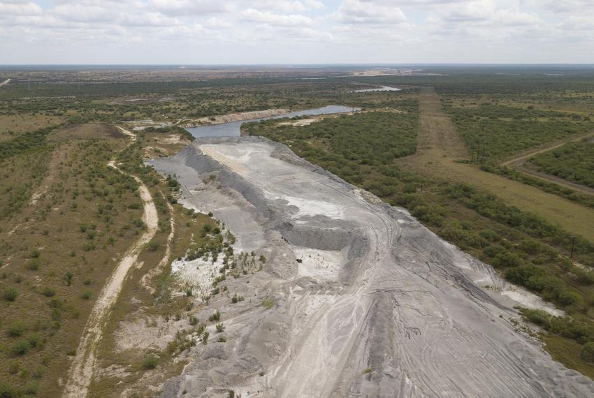 A mountain of coal ash sits near the Peeler Ranch in Jourdanton. The family claims the San Miguel Electric Cooperative has b…