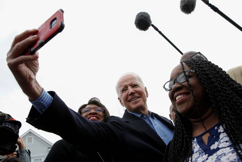 Democratic presidential candidate Joe Biden meets with people outside a Community Resource Center in North Charleston, Sou...