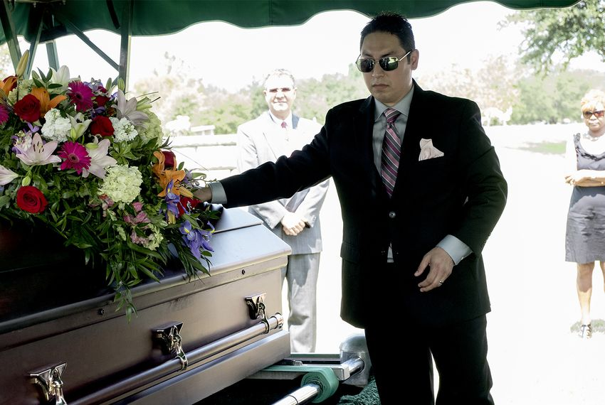 Chris Zavala mourns the loss of his wife, Michelle Zavala, during her funeral service at Cook-Walden/Capital Parks Funeral Home in Pflugerville on Aug. 5, 2017. Michelle died a week after giving birth to their daughter, Clara.