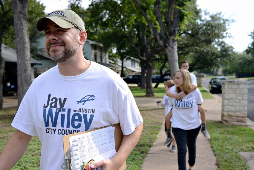 Jay Wiley, a candidate for Austin City Council, block walked on Saturday with campaign team member Corey Rose, back, and W...