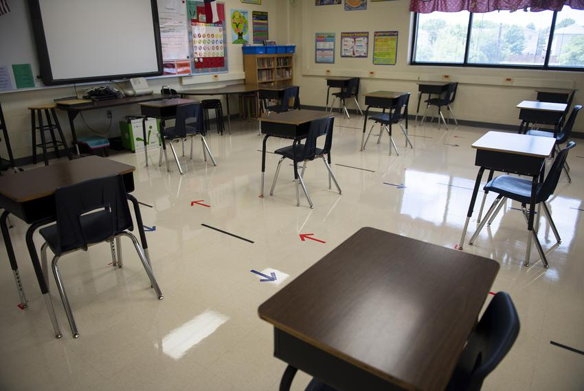 Desks are spaced out in a classroom at Ott Elementary School on Tuesday, Aug. 11, 2020 in San Antonio. The arrows on the f...
