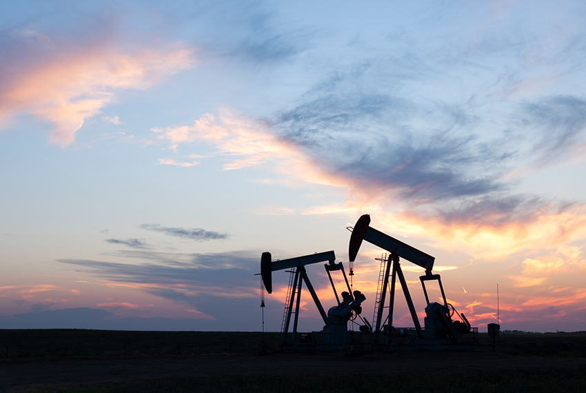 Oil pumps during sunset.