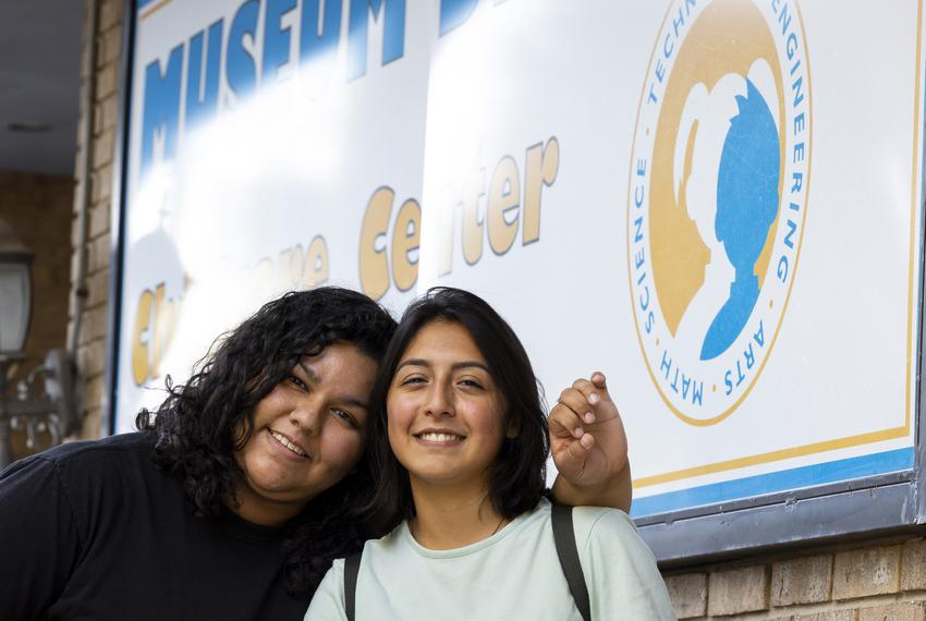 Museum District Childcare Center caregivers Issa Arevalo and Mishelle Acosta take off their masks after hours for a quick ph…