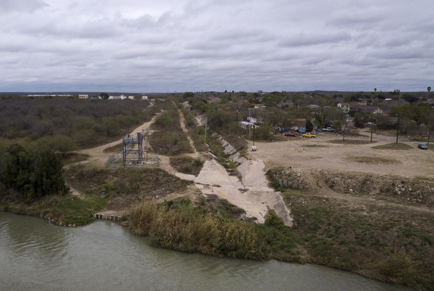 A culvert runs perpendicular to the Rio Grande in Webb County. This strip of land is planned to be assesed by the federal ...