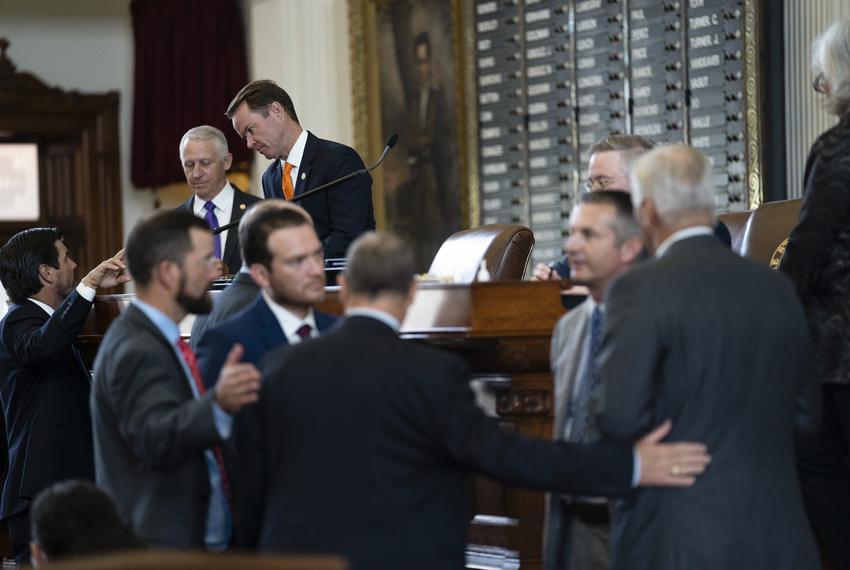 House Speaker Dade Phelan talks with other legislators on the House floor on July 20, 2021.