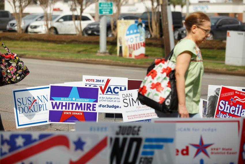 Campaign signs are up for the primaries outside an early voting location in Houston on Feb. 21, 2018.