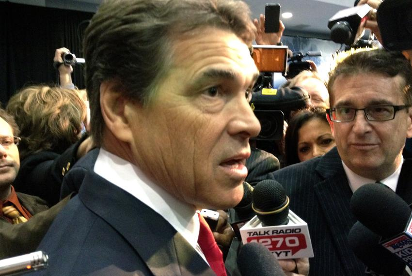 Gov. Rick Perry talking to the media after the CNBC Republican presidential debate on Nov. 9, 2011.