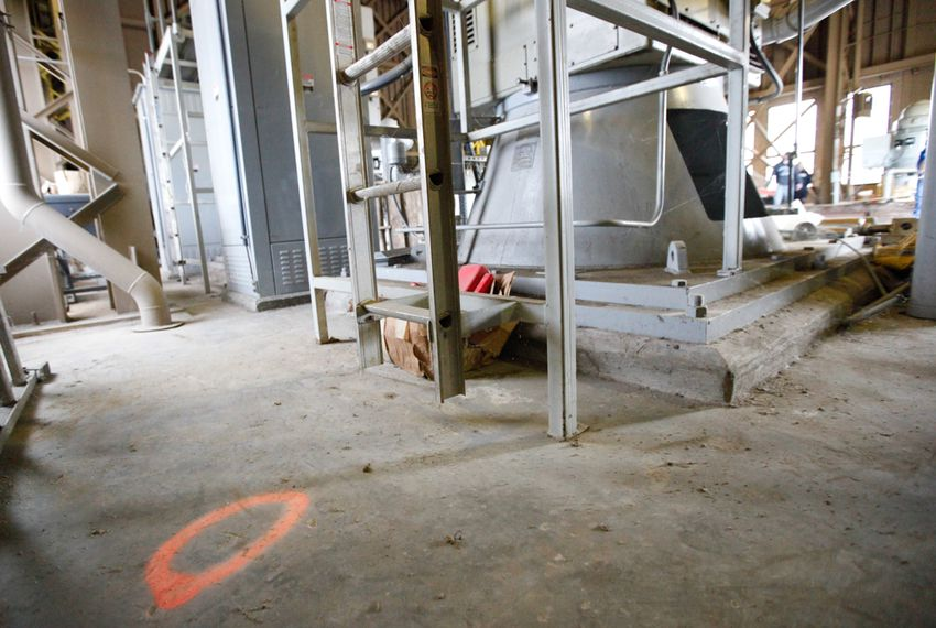 An orange circle on the floor of a raw water pump station on Lake Texoma indicates the state line between Texas and Oklahoma.