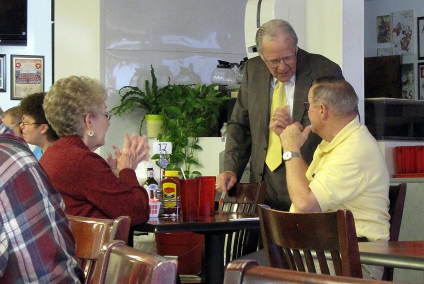 Rep. Delwin Jones (standing) talks to voters in a Lubbock diner.