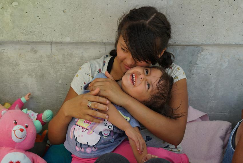 Evelyn Teresa Becerra Ramos, 21, holds her 2-year-old daughter, Jennifer, on the bridge between Matamoros, Mexico, and Bro...