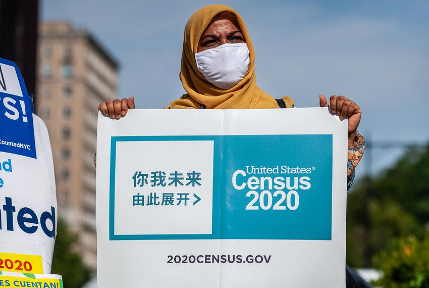 An activist holds up a sign urging Americans to fill out the 2020 Census during a rally in New York on Aug. 2, 2020.