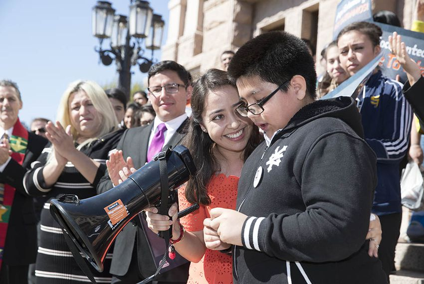 "A 9-year-old boy is encouraged by Karla Perez after he discusses his fears for his family related to recent Immigrations and Customs Enforcement raids in the Austin area  A coalition of immigrant rights groups rallied at the Texas Capitol on March 15, 2017, before a Texas House committee considered ""sanctuary cities"" legislation."