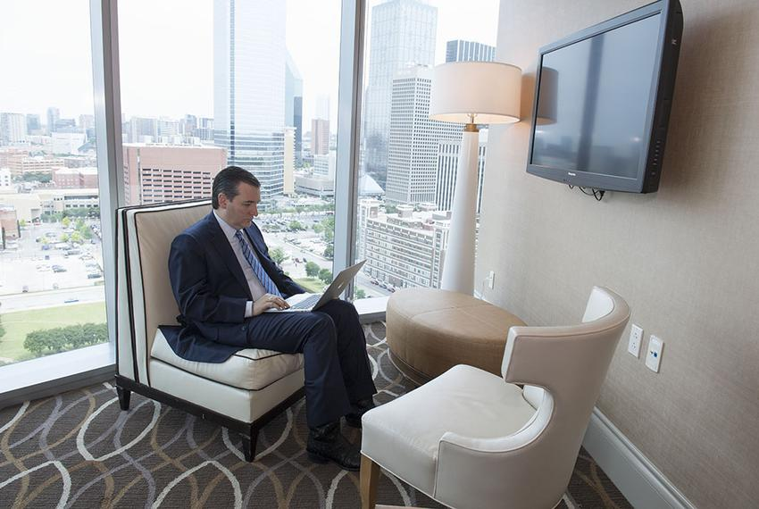 U.S. Sen. Ted Cruz sits by himself in a hotel suite as he prepares for his keynote speech to Republican delegates in Dallas …