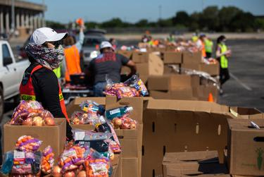The Central Texas Food Bank hosts a food drive at the Toney Burger Activity Center in Austin on April 30, 2020.