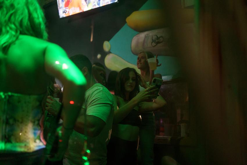 As the night wore on, more and more people gathered inside The Vault in downtown San Marcos for drinks and dancing. Gov. Gre…