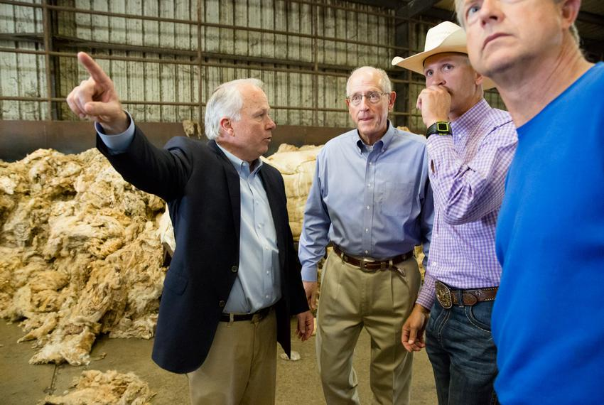 U.S. Rep. Mike Conaway, R-Midland, and other members of the House Committee on Agriculture visit a wool processing fiber mil…