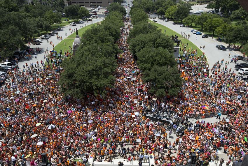 Activists converge at the south steps of the Texas Capitol as the second special session begins July 1, 2013.