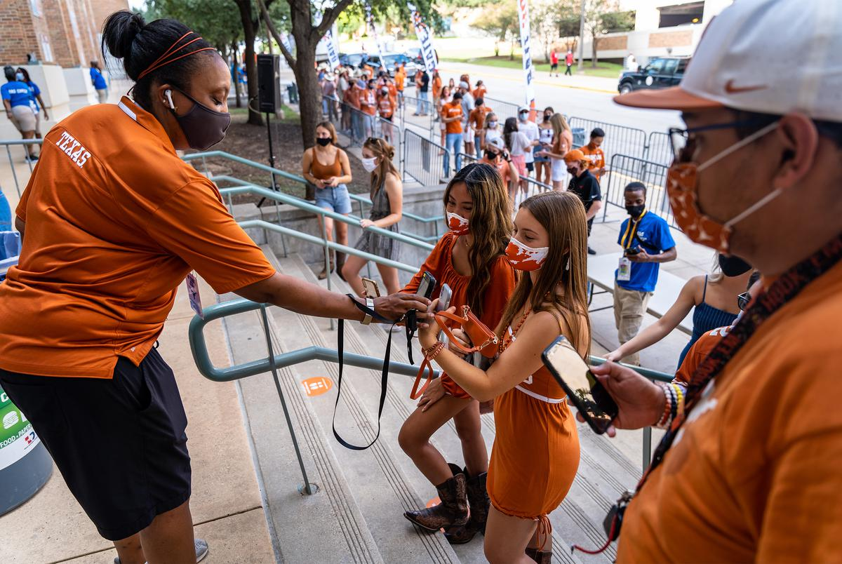 Scanning tickets at the student entrance to the Darrell K Royal-Texas Memorial Stadium for the first home football game of the season at the University of Texas at Austin on Sept. 12, 2020.