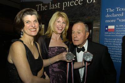 Former U.S. President George H.W. Bush and Luci Baines Johnson, left, accept awards in March 2005 from the Texas State History Museum Foundation in Austin. |