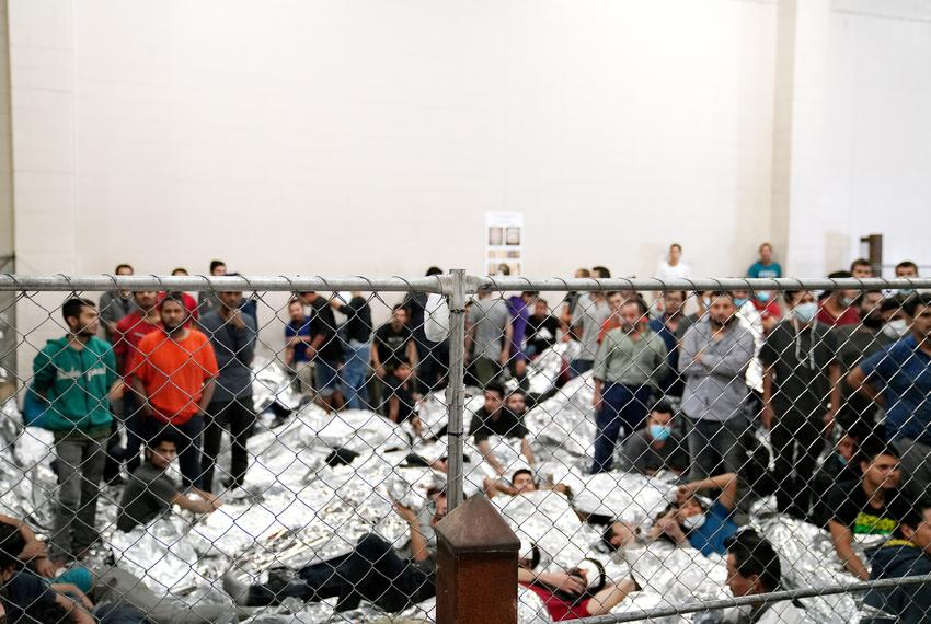 Single-adult male detainees stand at a Border Patrol station in McAllen on July 12, 2019.