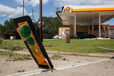 A broken traffic light hangs to the street after Hurricane Laura's wind blew through Orange. Aug. 27, 2020.
