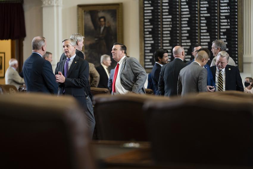 Legislators talk on the House floor on July 29, 2021.