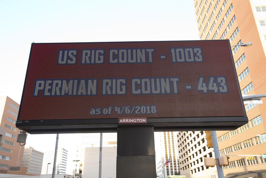 An electronic sign in downtown Midland displays oil and gas prices along with current rig counts in both the Permian Basin a…