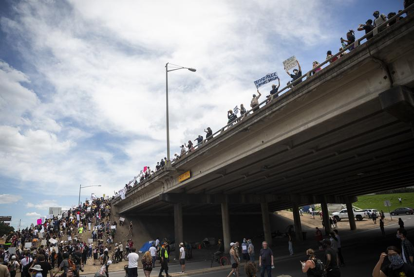Hundreds of protesters met at the Austin Police Headquaerters in downtown Austin and proceeded to take over both sides of In…