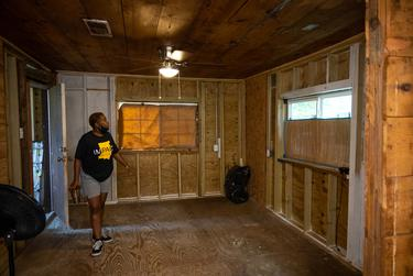 Sandra Edwards walks through her home in Houston's Fifth Ward, still being rebuilt after heavy damage from Hurricane Harvey in 2017.