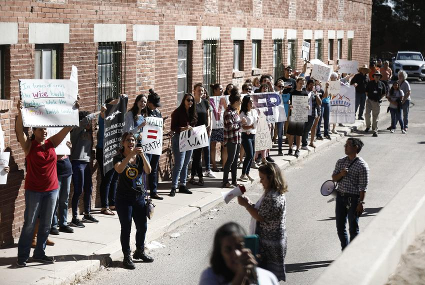 Protesters demonstrate during a press conference announcing new border fencing near downtown El Paso on Sept. 21, 2018.