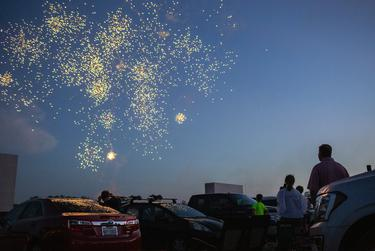 People attend a fireworks show at Doc's Drive In Theatre in Buda to celebrate the Fourth of July holiday.