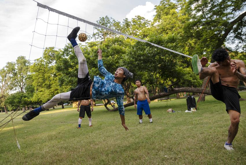 A group plays a Thai game of Takraw at White Rock Lake in Dallas on June 13, 2021. The group, who are all vaccinated, had no…