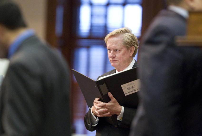 State Rep. Jim Pitts, R-Waxahachie, holds his bill book while listening to evening debate on SB1811 in the Texas House on ...