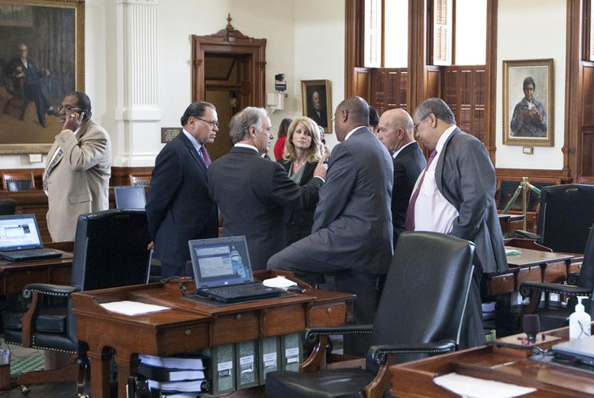 Group of Texas Senate Democrats huddle on Senate floor during break on May 30th, 2011