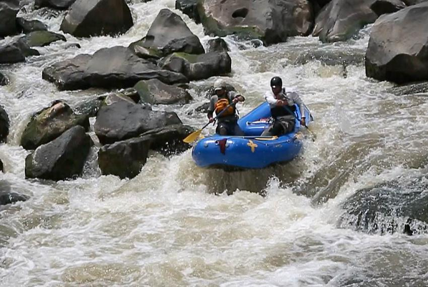 Garret Schooley, left, and Neil Cheesewright take a two man raft down the Upper Box of the Rio Grande Gorge.