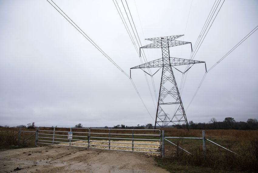 An access gate to power lines is closed near a ranch in Grimes County. The roughly 1,000-acre ranch is in the proposed path of a high-speed rail line that would connect Dallas and Houston.
