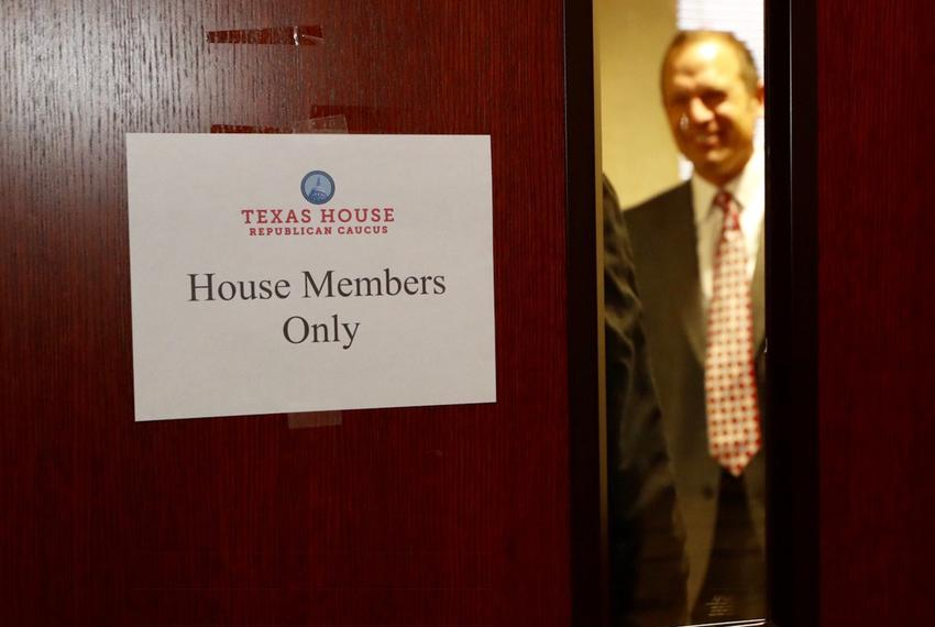 State Rep. Jason Isaac, R-Dripping Springs, closes the door as the House Republican Caucus prepares to meet in Austin on D...