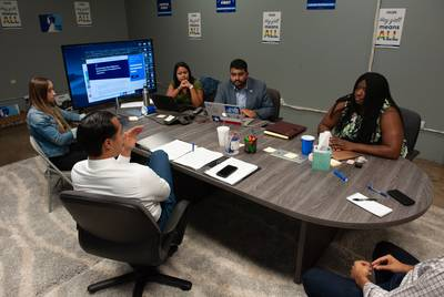Maya Rupert, (right)  campaign manager for Julian Castro, listens to the candidate during a recent meeting.