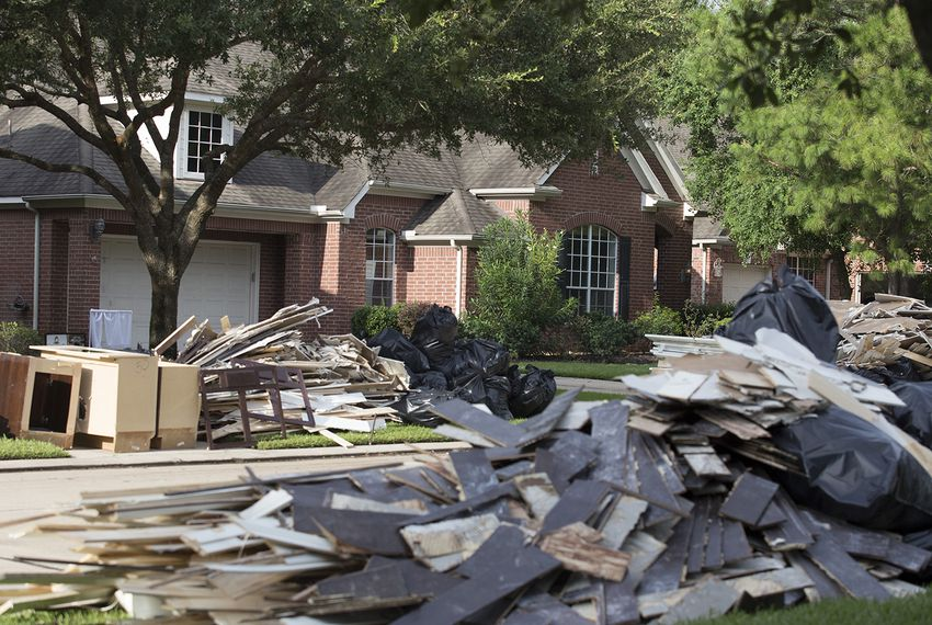 Rubble from Harvey flooding piled in front of a home in the Stable Gate subdivision in Cypress on Wednesday, Aug. 30, 2017.