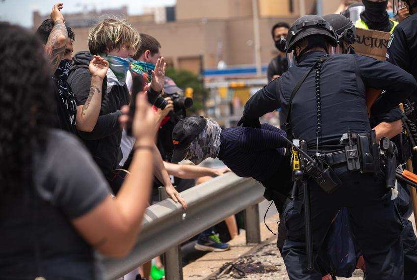 Hundreds of protesters met at the Austin Police Headquarters in downtown Austin and proceeded to take over both sides of Int…